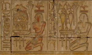 Sunk relief of personified provinces of Egypt bearing offerings for the temple god. Temple of Ramesses II at Abydos.