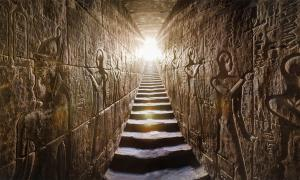 Temple of Edfu passage with glowing walls of Egyptian hieroglyphs on either side.Source: Konstantin / AdobeStock