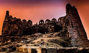 A view of ruined fort of Tughlaqabad, created during the Delhi Sultanate, at sunset.