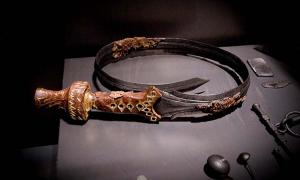 A beautifully decorated bent sword, 826-600 BC, part of the finds in a noble's grave at Oss in The Netherlands.