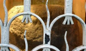 The London Stone, seen through its protective grille.