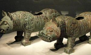 Fittings in the form of tigers, Baoji, Shaanxi province, Middle Western Zhou dynasty, c. 900 BC, bronze - Freer Gallery of Art.
