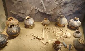A reconstruction of a burial site from prehistoric China. In Yinxu, about 2,500 pits filled with remains of sacrificial victims have been found in addition to other cemeteries were elites and other locals were buried.
