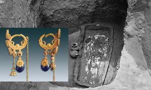 Main: 1,500-year-old tomb holding the coffin and skeleton of a woman named Farong, in Datong City, China. Inset: Two gold earrings were found beside Farong's skull in Datong City, China.
