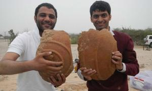 Ali Al Meqbali and Abdulla Al Kaabi with Dilmun storage jar fragments unearthed from Sir Bani Yas.
