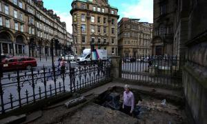 Simon Brooks showing the section of Hadrian's Wall that's been found on Westgate Road outside the Mining Institute