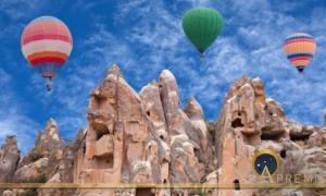 Colorful hot air balloons flying over Red valley in Cappadocia, Anatolia, Turkey (Svetlana Nikolaeva/ Adobe Stock)