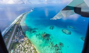 Aerial view of Funafuti atoll and the airstrip the airport in Vaiaku       Source: Dmitry/ Adobe Stock)