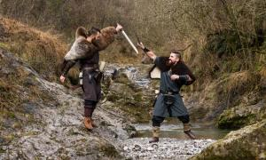 Two Viking re-enactors fighting
