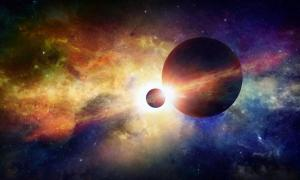 Two planets in space, glowing mysterious nebula in universe.
