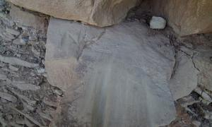 Letters and shapes crudely scratched into prehistoric grinding slicks on the Petroglyph Point Trail, permanently damaging these artifacts.