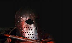 Recreated Viking helmet and weapon