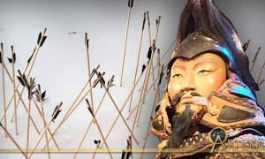 Exhibit featuring Mongolian arrows, and Mongolian soldier model