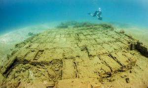 A diver inspects wooden crates on a 17th-century Spanish shipwreck discovered off Panama.