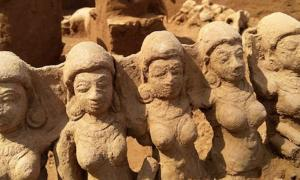 Some of the ancient idols found alongside a riverbank in Kerala, India.