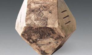 "A fourteen-sided die may have been used to play the ancient game of ""bo""."