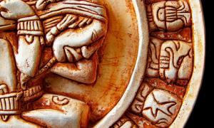 Closeup of glyphs on a Mayan calendar. Credit: zimmytws / Adobe Stock
