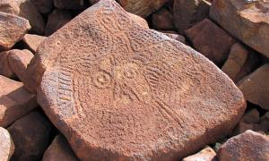 The enigmatic archaic faces, found in large numbers over the Burrup are among the earliest rock art works in the region.