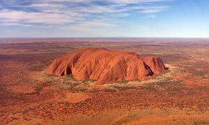 Uluru, also referred to as Ayers Rock, is sacred to the Pitjantjatjara and Yankunytjatjara, the Aboriginal people of the area. It has many springs, waterholes, rock caves and ancient paintings. Uluru is listed as a World Heritage Site.