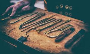 Surgical instruments of ancient physicians. Credit: Kai Beercrafter / Adobe Stock