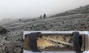 The Lendbreen ice patch. (Espen Finstad, secretsoftheice.com) Insert: The box found at the ice-patchcontaining a well-preserved beeswax candle. (Secrets of the Ice)