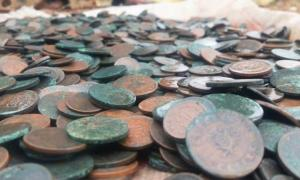 The lucky man found the buried treasure on a plot of land he bought with lottery winnings. Source: Yahoo