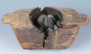 Wooden brazier used for recreational cannabis use. Source: Xinhua Wu / Science Advances