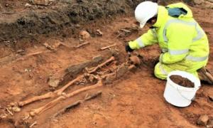 The site includes a cemetery of 18 humans buried from east to west in the Christian fashion from an as-yet undated era. As of press time, bits of bone have been sent off for radio carbon dating.
