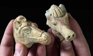 Left: The clay horse head from the Hellenistic period. Right: The Iron Age clay horse head