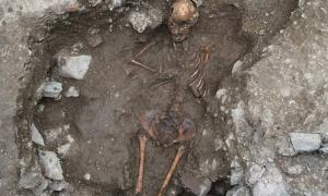 "Italian archaeologists have unearthed the remains of a teenage  girl given a ""deviant burial"" because she appeared different from and possibly scared her fellow villagers."