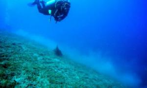 A diver works another ancient shipwreck off the coast of Italy, in 2012