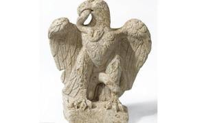 Eagle eating serpent sculpture