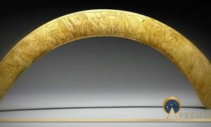 Magic Wand of hippopotamus ivory (Middle Kingdom-Second Intermediate) depicting a procession of deities. The curve of this wand follows that of the hippopotamus tusk from which it was made, but its flat form is reminiscent of the curved throwing sticks used to catch fowl. Powerful protective deities, such as Taweret and Bes, are depicted together with protective uraeus serpents and other mythical creatures. Many of the figures brandish knives to dispel evil spirits.
