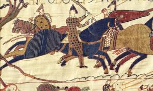 : A segment of the exquisite Bayeux Tapestry. In this scene Odo, Bishop of Bayeux (with raised club), half-brother to William the Great, rallies the troops in the Battle of Hastings in 1066.