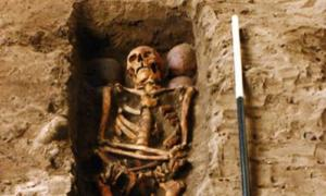 The grave holding one of the skeletons and the four skulls. (FAS Heritage / Fair UseThe reconstructed face of the clansman who was killed in the 15th century.