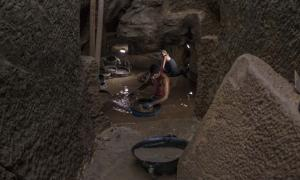 The flooded tomb is being sifted through by a research team in Gebel el Silsila, Egypt.