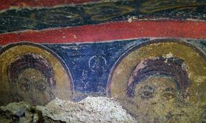 Two of the frescoes from the church, which is in a region of 200 underground villages and tunnel towns.