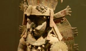 Terra cotta image of Maya Rain God Chac at San Francisco's de Young museum.