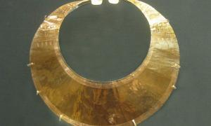 A gold lunula from County Wicklow. The piece, dating from 2400 BC to 2000 BC, is in the  British Museum. Note the decorations etched into the ends or horns of the lunula.