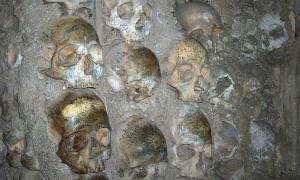 Close-up of human skulls that are part of the Chapel of Bones of the Church of San Francisco in Évora, Portugal.