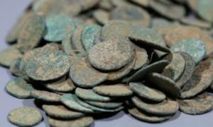 "Some of the 14000 Roman and Gallic coins that were found at Patrice T's home in Belgium that he claims he ""legally"" discovered in his Flanders field. Evidence clearly suggests that he stole these illegal artifacts from French soil and that's illegal!       Source: Agentschap Onroerend Erfgoed"