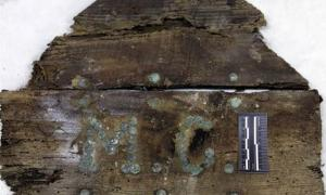 Initials M.C on a plank of a coffin found on unidentified graves in the Convent of the Barefoot Trinitarians