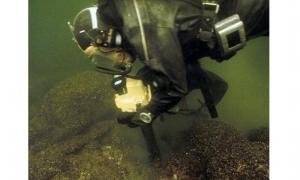 Rauno Koivusaari investigating wreck site.