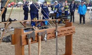 Paramedics aid man at Hawkesbury Showground in New South Wales after he was struck in the head with a Medieval axe