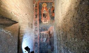 The well-preserved, brightly colored fresco of Saint Alexis and Christ the Pilgrim. Source: ABC