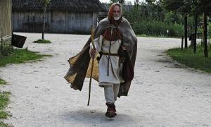 A reenactor dresses as a medieval pilgrim.