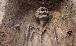 Archaeological excavation with skeleton, representational image only