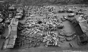 "A 2,100-year-old pit containing a mini ""Terracotta Army"" has been discovered in China."