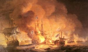 A confused naval battle. Two battered ships drift in the foreground while smoke and flame.