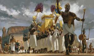 Nubian King leads his queens through a crowd during a festival